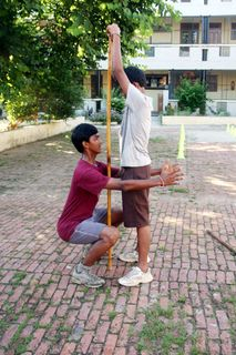 Shubham and Krishna Stick Squat
